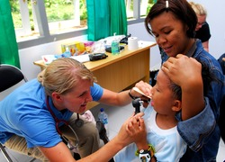 Normal_us_navy_100720-n-4044h-292_latter-day_saint_charities_nurse_practitioner_michelle_crawford_performs_a_general_examination_during_a_pacific_partnership_2010_medical_civic_action_program